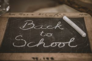 Back to school written on a chalk board for MyDepoz back to school essentials list of top 10 items for students to bring back to school